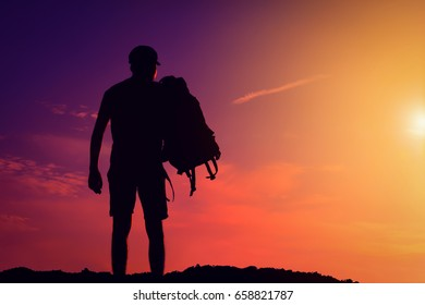 silhouette of the people with a shoulder bag to see the sun Sky background
