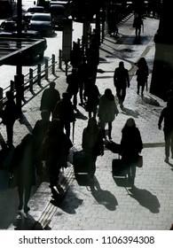 silhouette of people walking down on street
