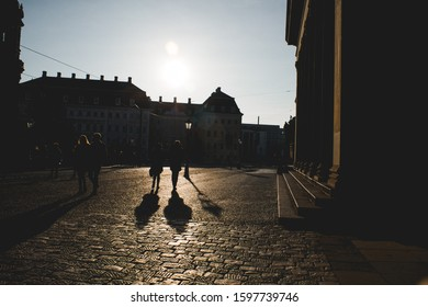 Silhouette of people walking in Dresden