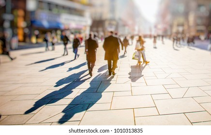 silhouette of people walking on city streets