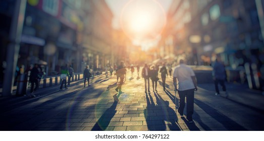 Silhouette of people walking on the street of big city