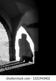 Silhouette of a Person in an ancient door