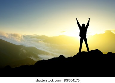 Silhouette of person in mountain. Sport and active life