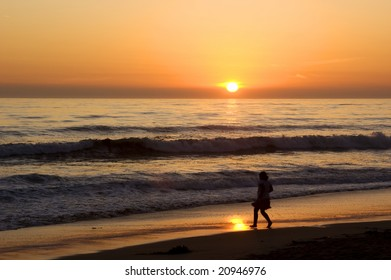 Silhouette of person playing on a California Beach at sunset