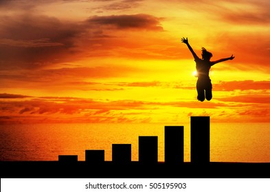 Silhouette, personal development and career growth, Business or education concept growth success process, Woman jumping on chart in the beach.