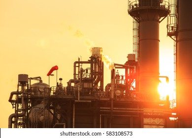 Silhouette and Petrochemical industrial plant power station at sunset