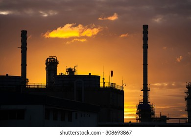 Silhouette of petrochemical industrial plant in sunrise