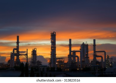 Silhouette of petrochemical plant or Oil and gas refinery at twilight