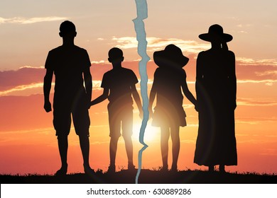 Silhouette Photo Of A Family With Crack Against The Dramatic Sky At Sunset
