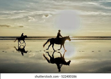 Silhouette photo of horse riding in the evening sunset time , dramatic style