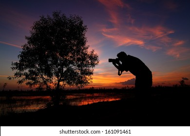 Silhouette photo of photographers
