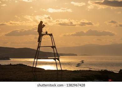 silhouette photograper with baikal lake view
