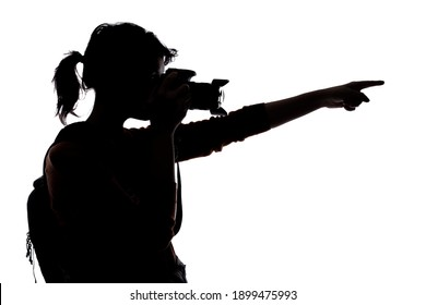 Silhouette of a photographer with a camera on a white background isolated for composites. She is pointing forward