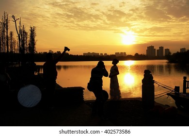 Silhouette, photographer in photography in the sunset