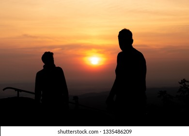 Silhouette of photographer at sundown