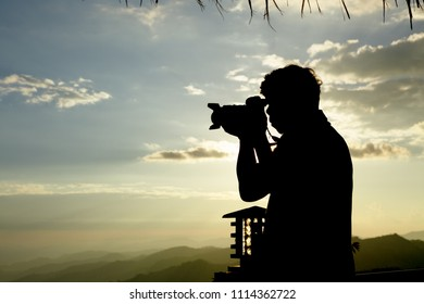 Silhouette photographer at sunnet