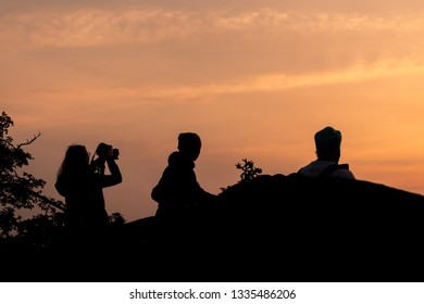 Silhouette of photographer at sunrise