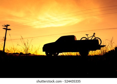 4ba99e4cd3 Silhouette Pickup truck with bicycle at sunset sky