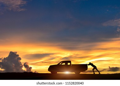 Silhouette of pickup truck on the background of beautiful sunsetPeople drive the car down the road is not difficult.