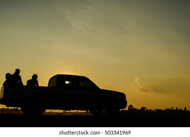 Silhouette of pickup truck on background of beautiful sunset