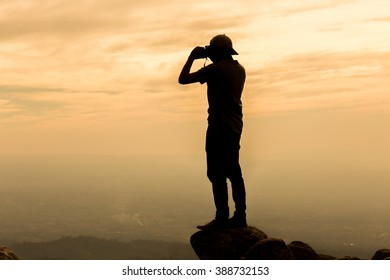 Silhouette picture of a man stand on the hill in the sunset scene