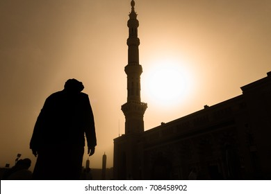Silhouette picture a man and a tower of Nabawi Mosque.