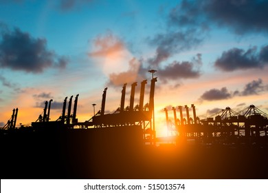 Silhouette pier used to transport cargo to different countries around the world.Business Logistics concept.Cargo freight ship for Logistic Import Export background.transport industry concept