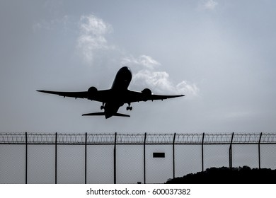 silhouette of a plane take off