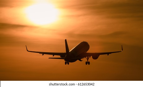 Silhouette plane take off in evening