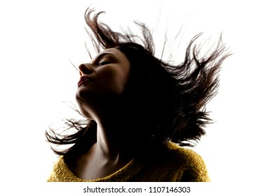 silhouette portrait of a beautiful caucasian girl with waving hair