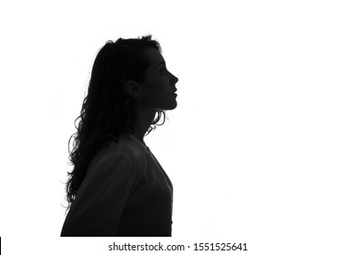 Silhouette portrait of a beautiful young girl with long hair isolated on white background