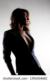 silhouette portrait of sexy girl in a suit