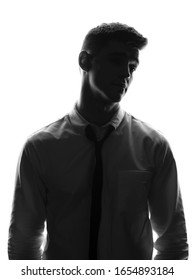 Silhouette portrait of young business man in white shirt. Office worker concept. Isolated white background.