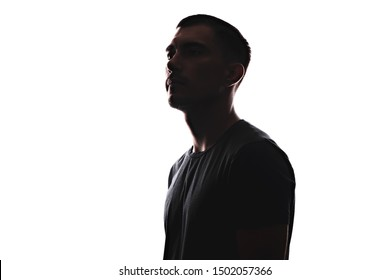 Silhouette portrait of young European man in profile isolated white background