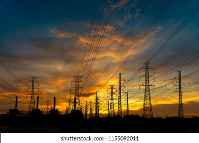 Silhouette power plant and high voltage electric tower on sunset time and sky on sunset background. Power Tower