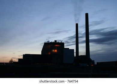 Silhouette of a power station - Deep glow coming from core