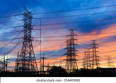 Silhouette power transmission tower  during twilight time