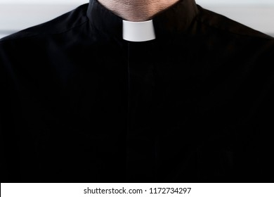 Silhouette of a priest without a face