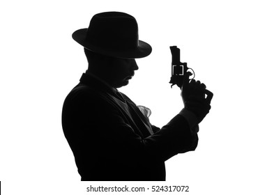 Silhouette of a private detective with a gun in right hand. Gangster looks like mafiosi Al Capone and stay side to camera. Police criminal scene in black and white. Isolated or cutout.