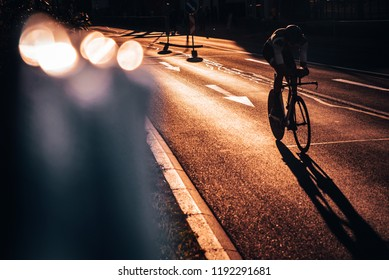 Silhouette of professional cyclist in sunset light, individual Time Trail