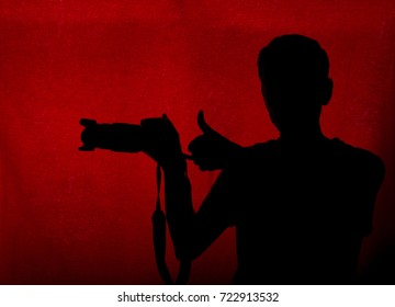 Silhouette of professional male photographer