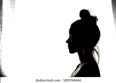 silhouette profile of an anonymous woman