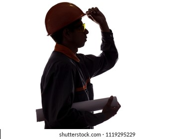silhouette profile of construction worker with project in hands, man in overalls in hard hat and safety glasses on white isolated background,concept of building, heavy industry, profession