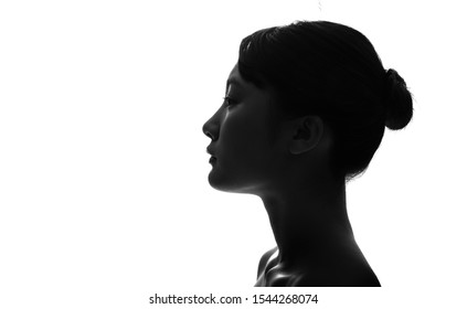 Silhouette of profile of a young asian girl.