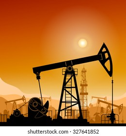 Silhouette  Pumpjack or Oil Pump on a Background of Mountains  at Sunset, Petroleum Industry , in the Background Working  Oil Pumps and Drilling Rig