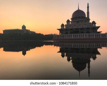 Silhouette Putrajaya Mosque Against beautiful sunrise sky