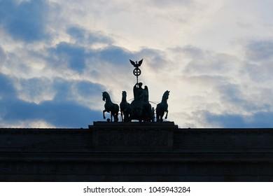 silhouette of the Quadriga at Brandenburger Tor, Berlin, at sunset