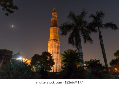 Silhouette of Qutub Minar a highest minaret in India standing 73 m tall tapering tower of five storeys made of red sandstone. It is UNESCO world heritage site at New Delhi,India