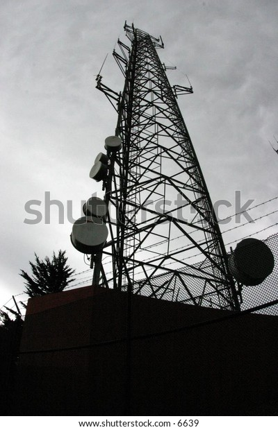 silhouette of radio tower at dusk