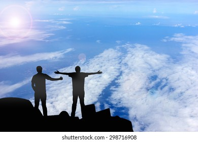 Silhouette of the real friend on the peak of mountain.Everyone need real friends
